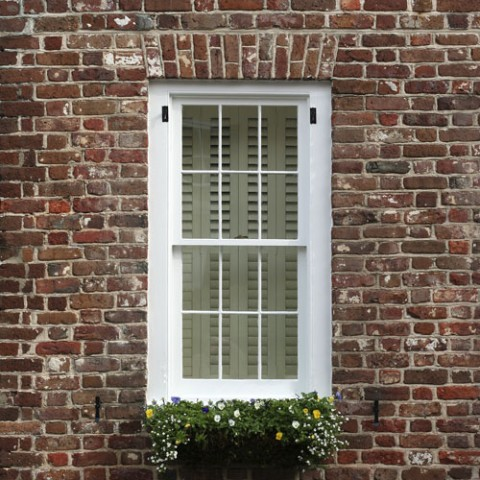 Photo of a sash window in a Georgian brick house