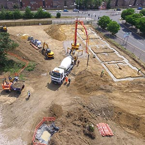 Aerial photo of a TOWN construction site showing foundations being poured for a terraced street